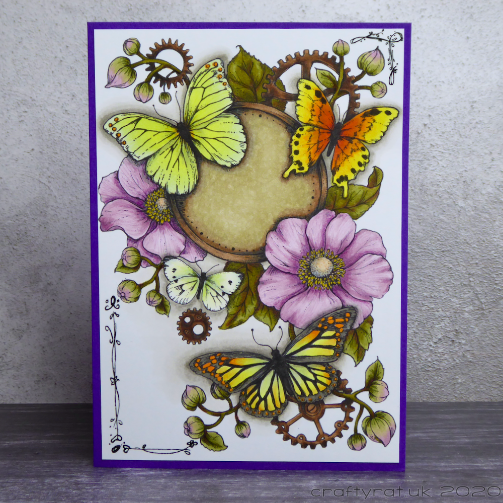 Greetings card with hollyhocks and butterflies and cogs scattered in the background.