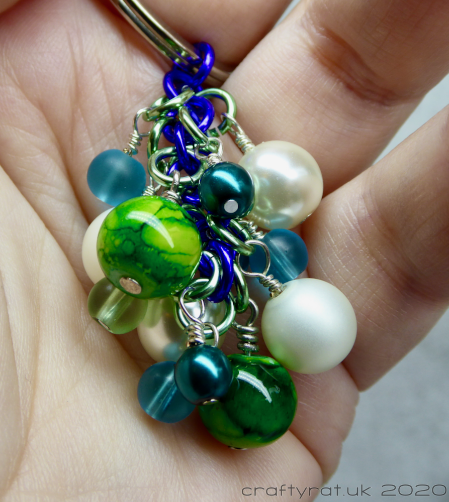 "The beaded ""dangle"" held in a hand."