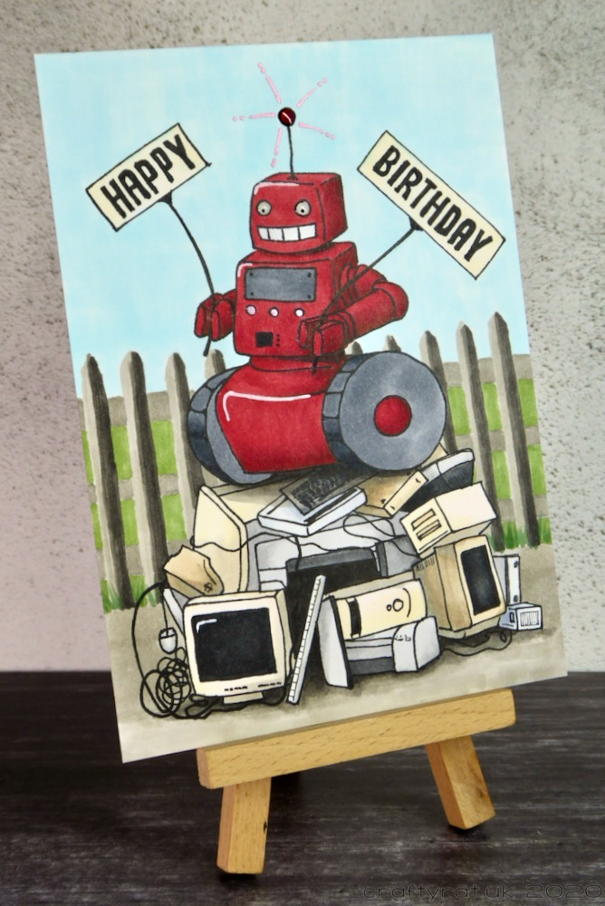 Junkyard robot birthday card displayed on a small wooden easel.