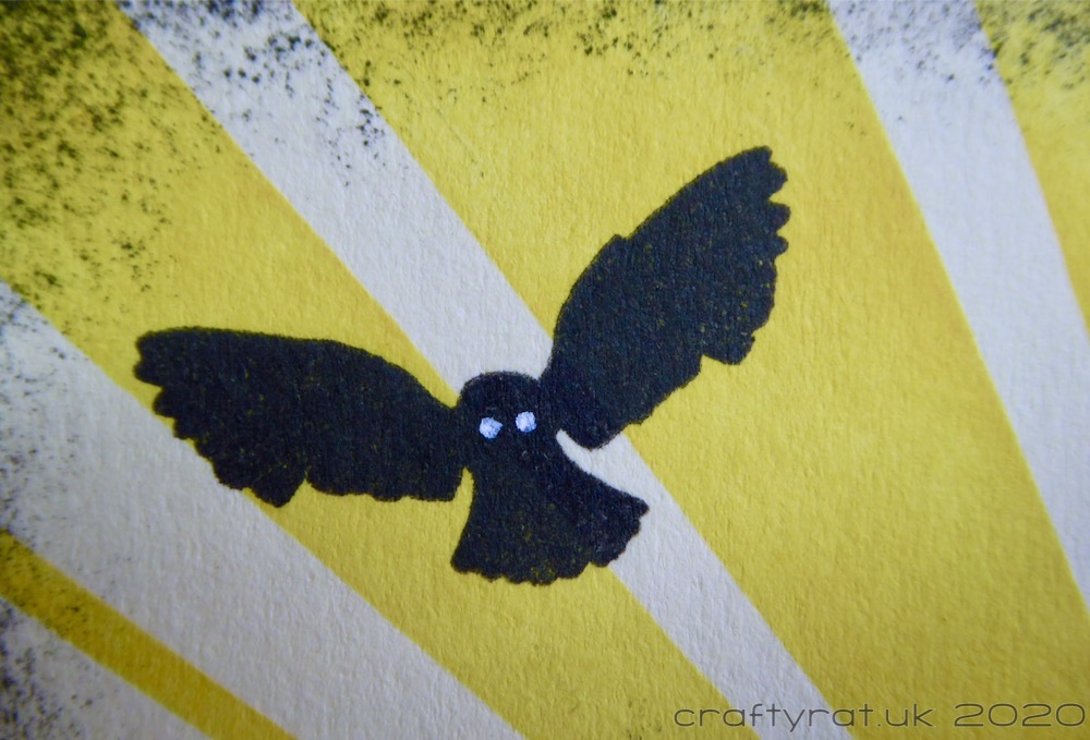 Close-up of the silhouetted owl in flight.