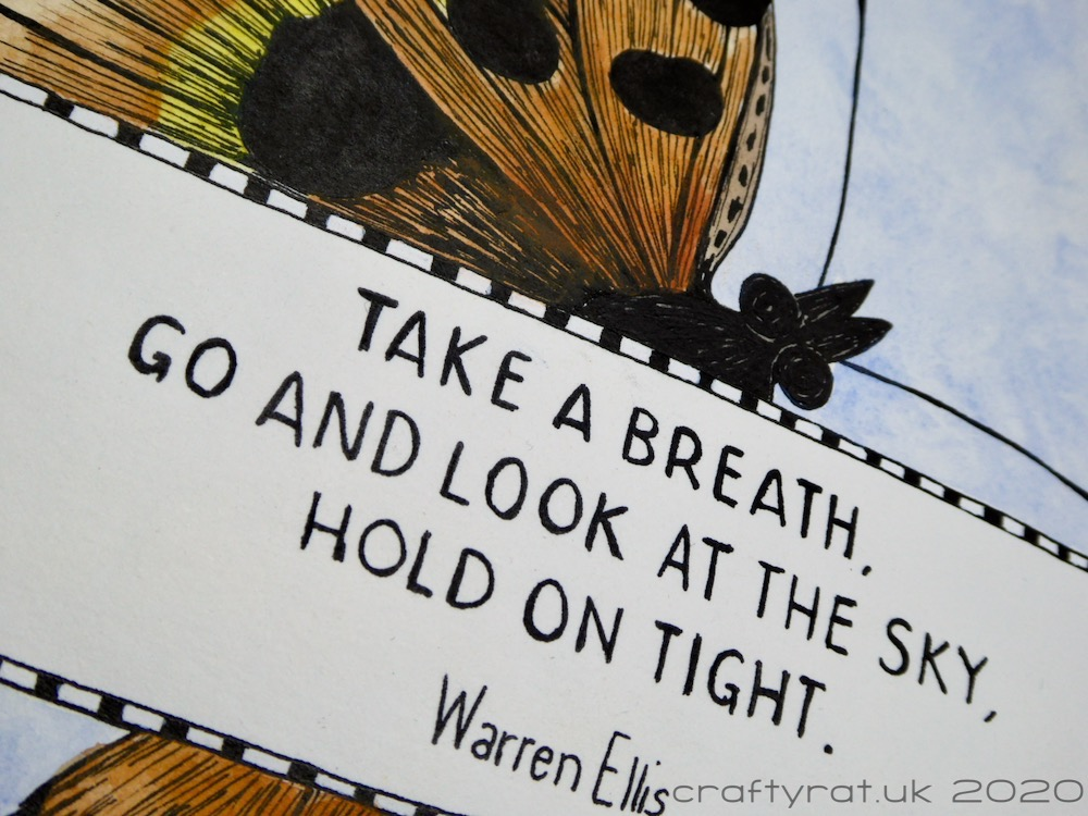 "Close-up of the Warren Ellis quote: ""Take a breath, go and look at the sky, hold on tight."""