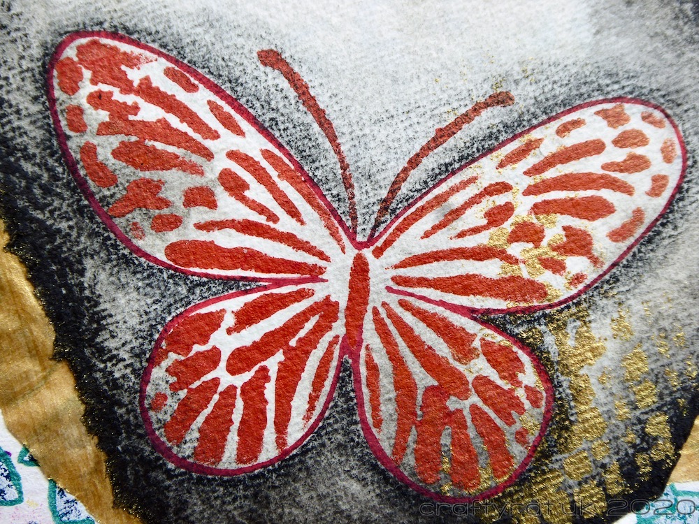 Close-up of one of the red stencilled butterflies.