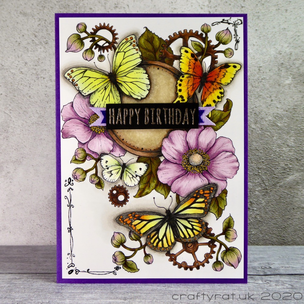 A birthday card with butterflies, flowers and cogs on it.