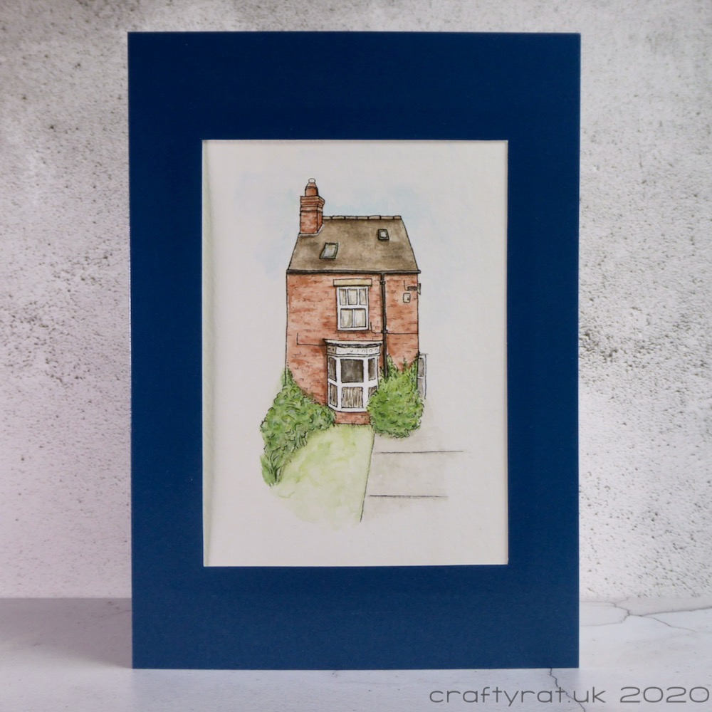 A card with an illustration of a house with a bay window.