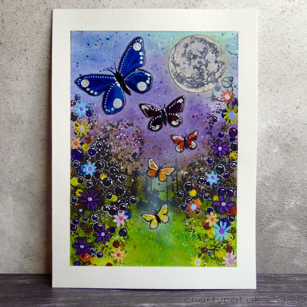 An artwork with four butterflies flying up the centre of the page from a grassy area surrounded by colourful flowers, bubbles and other texture. There is a large moon in the blue/purple sky.