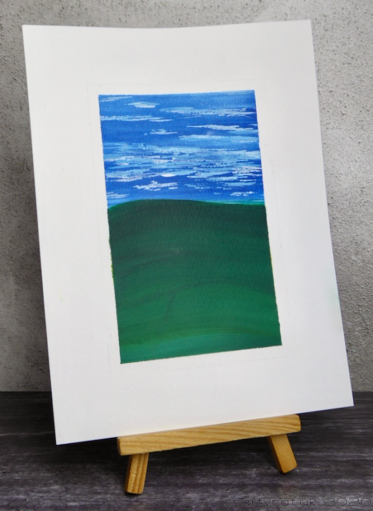The landscape displayed on a small wooden easel.