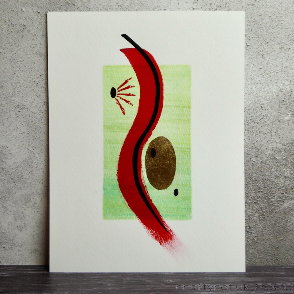 A small abstract painting with a curving red swipe of paint over a green background and gold and black ovals on either side in the concave  areas of the swipe.