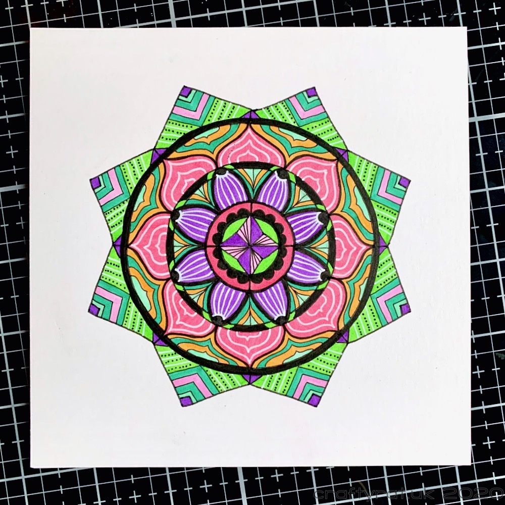 The much brighter first attempt at colouring the mandala.