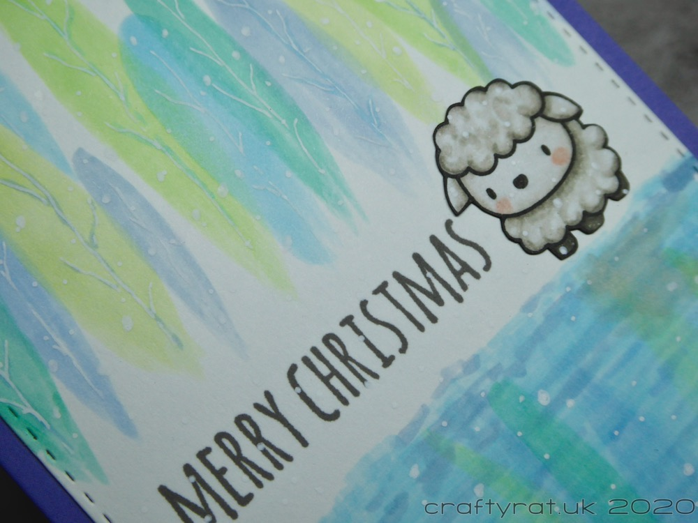 Close-up of the sheep and centre of the card.