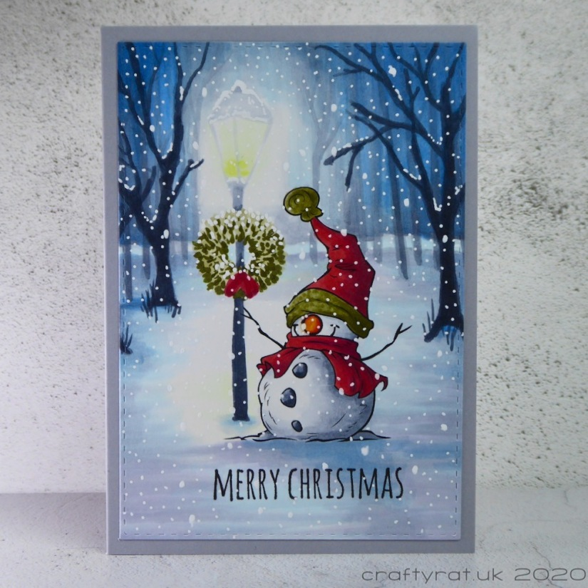 Copic-coloured snowman standing by a lamp in a snowy park.