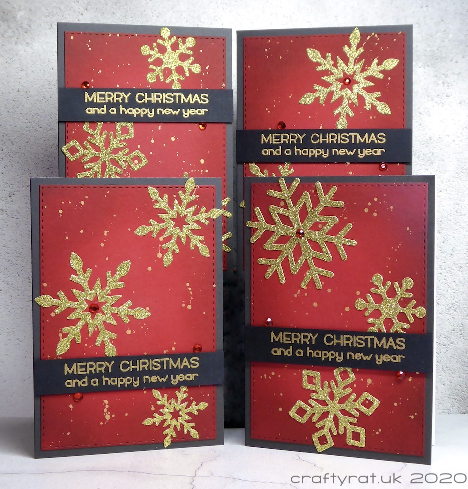 The four variant layouts of the Christmas card with different snowflakes and different positioning of the sentiment banner.