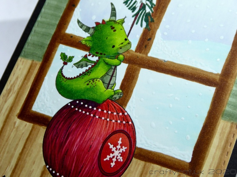 A close-up of the dragon on the bauble.