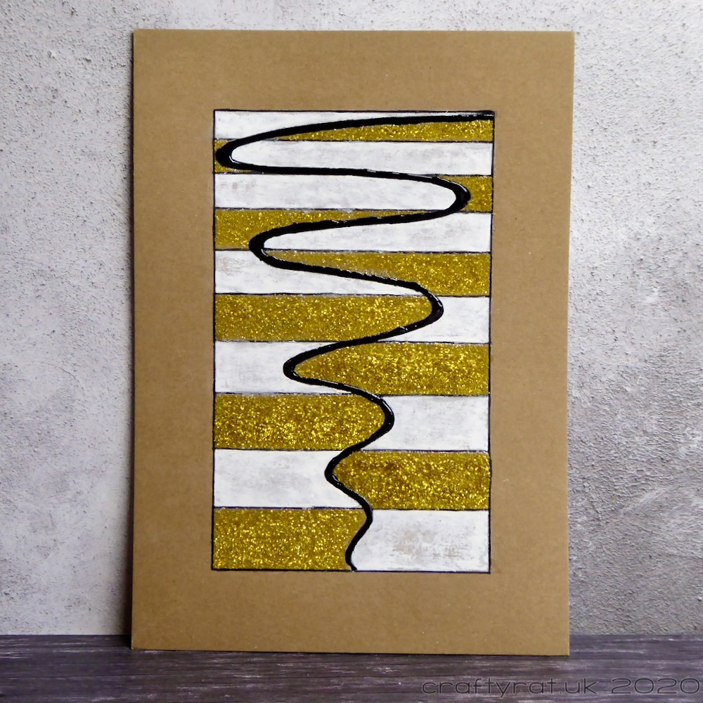Abstract piece with gold and white stripes divided by a flowing squiggle down the centre.