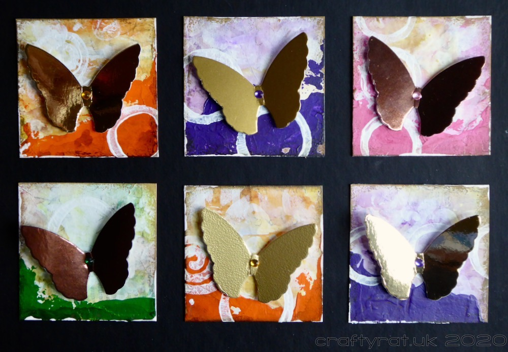 A close-up of six of the butterfly squares.