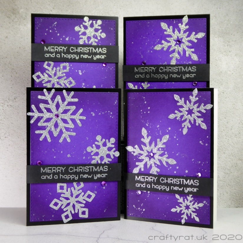 All four variants of the Christmas card design with the snowflakes and sentiment banner in different positions on each card.