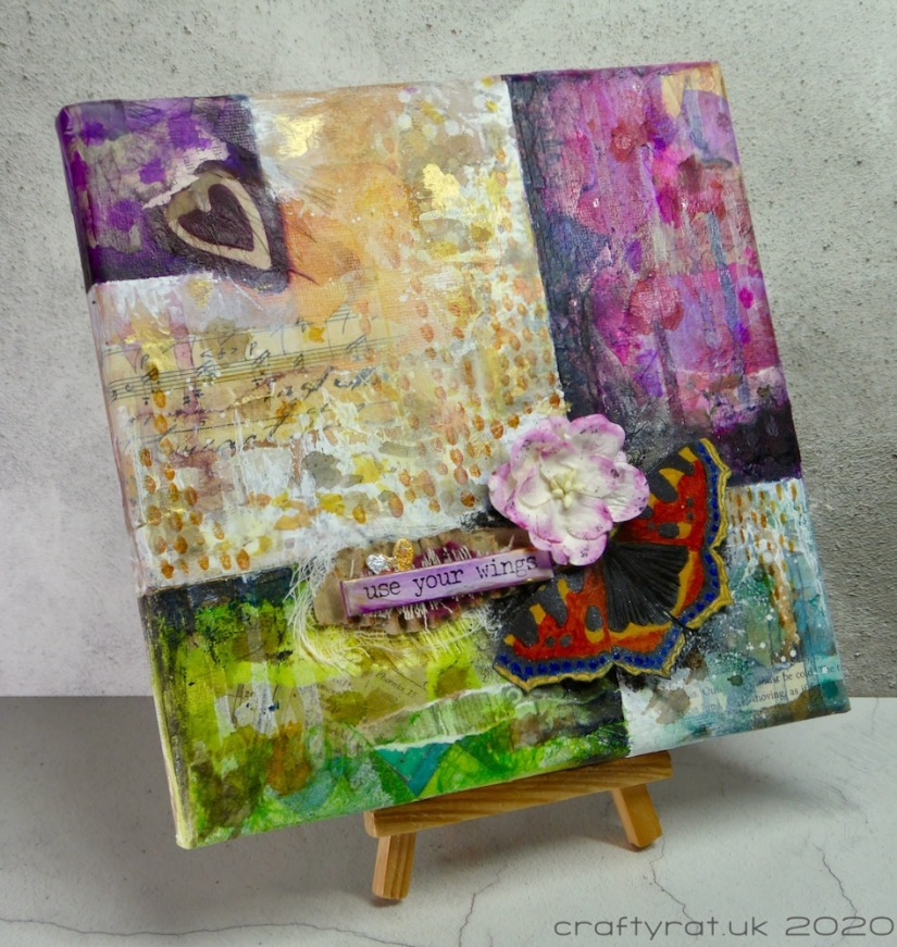 The canvas displayed on a small wooden easel.