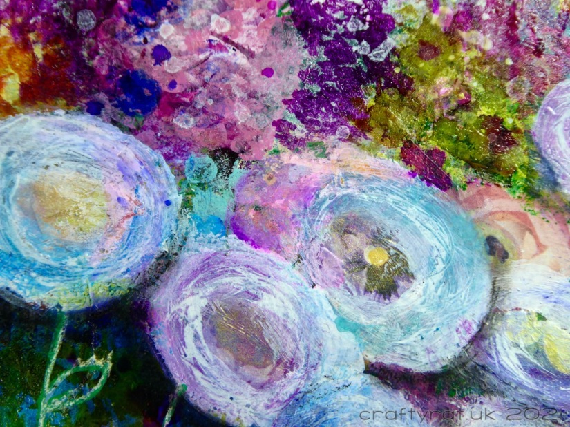 Close-up of the round flowers and background texture.