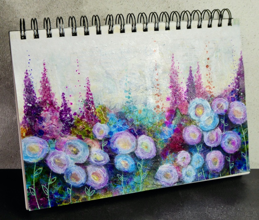 The flowery art journal page displayed at an angle.