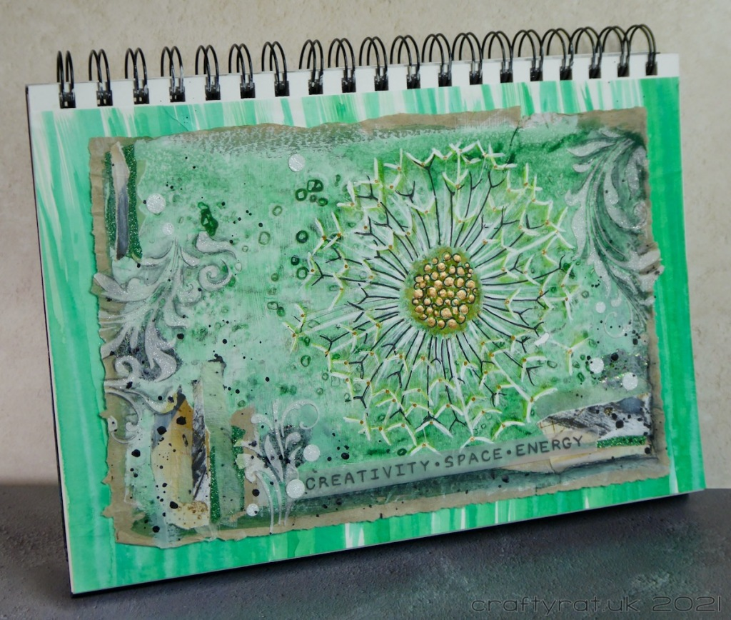 The art journal page displayed at an angle.