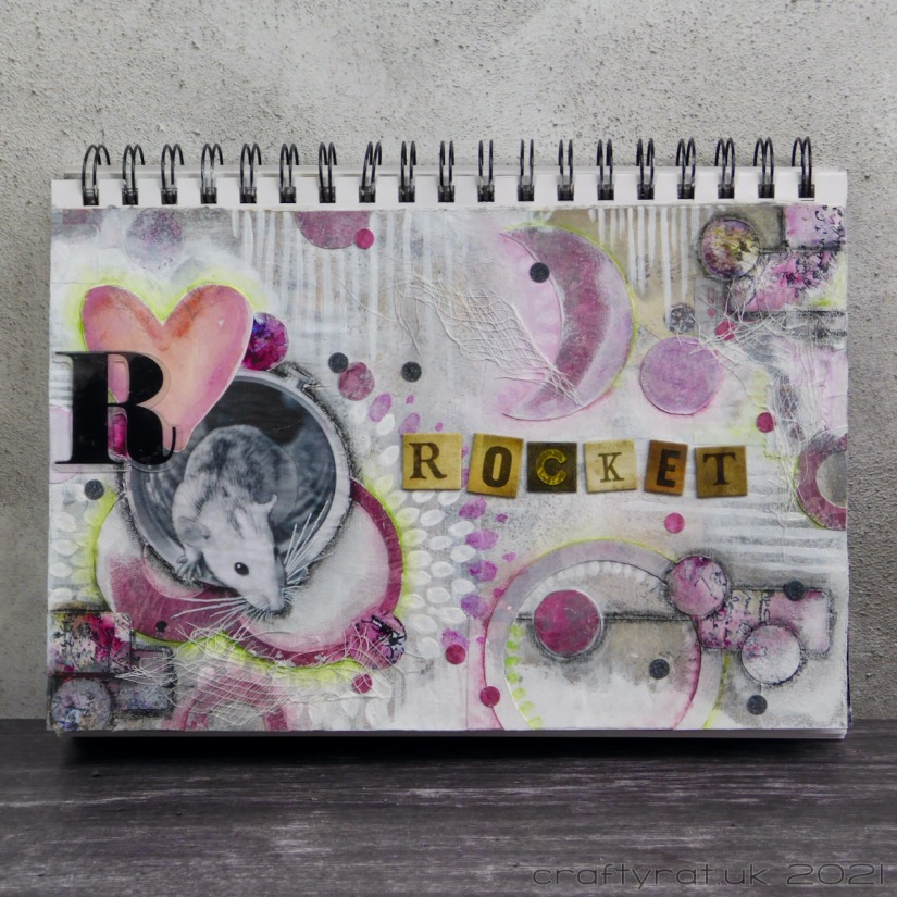 An art journal page for a rat named Rocket.