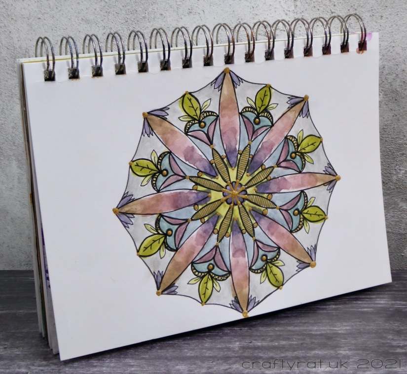 The art journal with the mandala displayed at an angle.